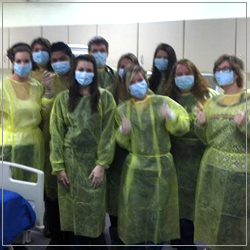 students in surgical uniforms